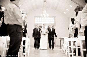 Bride walks down the aisle with two dads