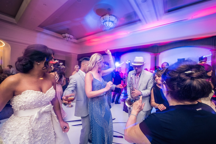 Dance floor with saxophone player playing at a fun wedding