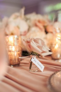 escort card on a single rose