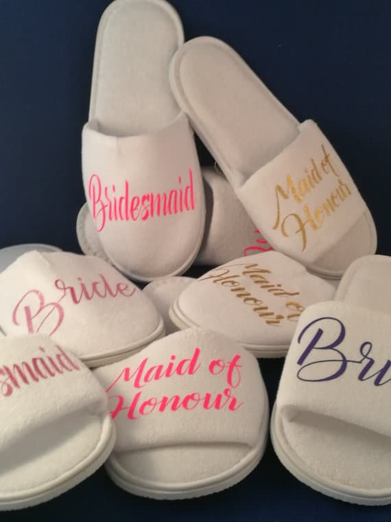 "slippers with ""bride"" ""bridesmaid"" and ""maid of honour"" on it"