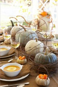 Pumpkins lining a dinner table