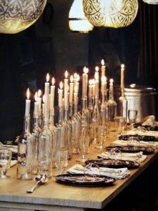Lots of mason jar candles lining a dinner table
