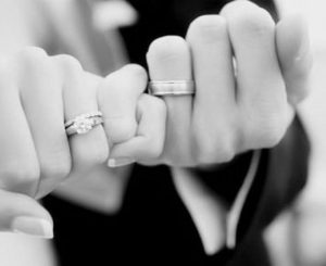 pinkie promise between bride and groom