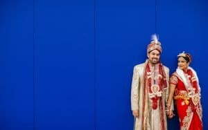 Blue Background with Bride and Groom in Traditional Wedding Attire