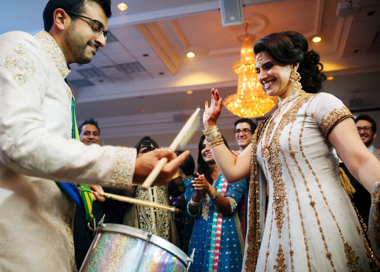 Bride and groom drumming at reception